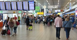 Crowded departure hall at Schiphol Airport