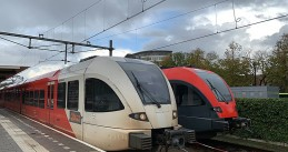 Two Qbuzz trains at Dordrecht station