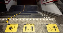 Social distancing icons placed at a stairwell at the train station in Almelo. 28 July 2020