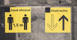 Signs placed on the pavement to remind people of social distancing rules at the Almelo train station. 28 July 2020