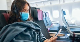 Woman wearing a mask on a plane