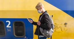 Student wearing a face mask next to a NS train during the summer of 2020
