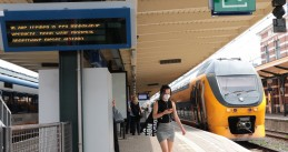 A woman wearing a face mask on a platform at the Hoorn train station. August 2020