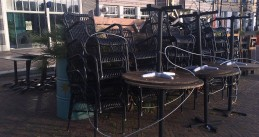 Tables and chairs stacked up on closed restaurant terraces in Amsterdam Oostpoort. 28 Oct. 2020
