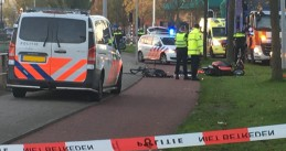 Police at the scene of an accident involving a bicycle and a scooter in Amsterdam Oost, 3 November 2020