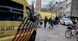 Paramedics and police gather at an Albert Heijn in The Hague where two people were stabbed and the store was set on fire. 2 Dec. 2020