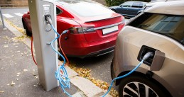 Electric cars charging on the street