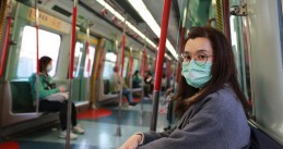 Masked people on a train in Wuhan, China