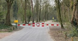 A gate blocking access to a parking location at the dunes in Soest.