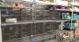 Empty shelves at an Albert Heijn store in Amsterdam Oost, 13 March 2020
