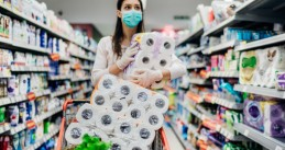 Shopping in Covid-19 pandemic - Buying toilet paper, wearing a mask