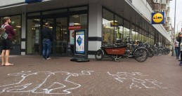 """Love is for all"" written outside a Lidl store in Amsterdam where a gay couple was verbally attacked on 18 April 2020"