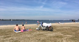 Sun seekers largely social distancing on Almere Strand, 21 May 2020