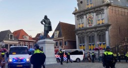 Police surround the J.P. Coen statue in Hoorn