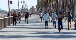 People wearing masks at Port Olimpic in Barcelona, Spain, June 2020