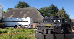 Police at the scene of a massive cocaine lab found in the Drenthe village of Nijeveen, 7 August 2020