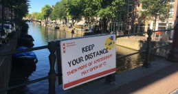 A sign on Korte Niezel promoting social distancing in Amsterdam. Aug. 5, 2020