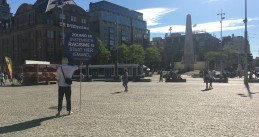 A lone protester against institutionalized racism standing in Amsterdam's Dam Square. August 5, 2020