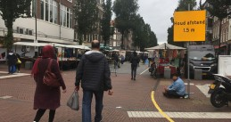 People warned to keep a safe social distance while entering the Dappermarkt in Amsterdam. 9 Sept. 2020