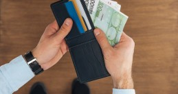 Man taking Euro banknotes from wallet
