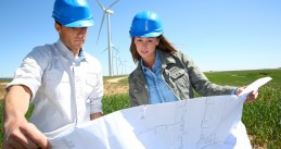 Engineers on industrial site for windmills