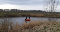 Police search the canal along Kanaalweg near Sluis for missing Ichelle van de Velde, 16 February 2021