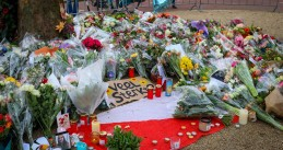 Flowers and candles left at the scene of a mass shooting on 24 Oktoberplein in Utrecht on 18 March 2019