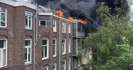 Fire swept across the rooftops on Ruyschstraat in Amsterdam-Oost. May 23, 2020
