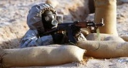 War in Syria. Soldier wearing gas mask.