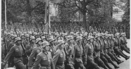 641px-German_troops_parade_through_Warsaw,_Poland,_09-1939_-_NARA_-_559369