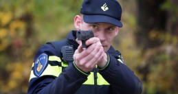 A police officer aiming his service weapon